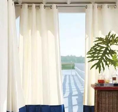 客厅和阳台效果图 巧妙搭配窗帘扮靓夏日美丽家